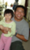 Lord's Grace Christian Church's Pastor Brian and an ICC child