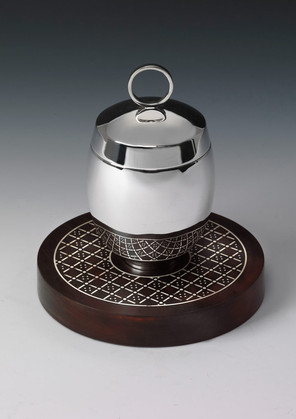 Shona Marsh, Tea Caddy, 2013, sterling silver and rosewood inlaid with silver, base 145 mms, caddy 135 mms x 80 mms wide, private collection, photo Graham Oaks,