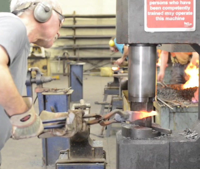Adrian Wolfe operates a powerhammer at Herefordshire and Ludlow College, 2013, film L.H.
