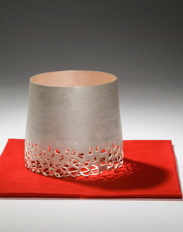 Anna Lorenz, Object on Red, 2009, fine silver, 9 cms x 10 cms, felt, 13 cms x 13 cms, private collection, photo Graham Hughes.