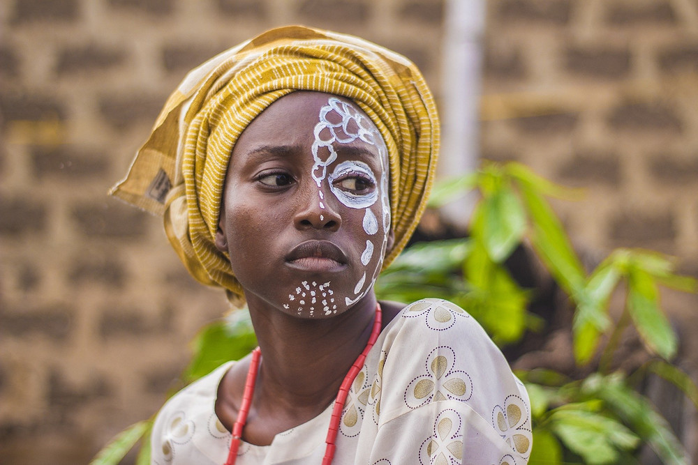 A close up of an African girl in a headscarf