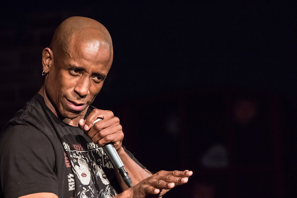 A black comedian on stage