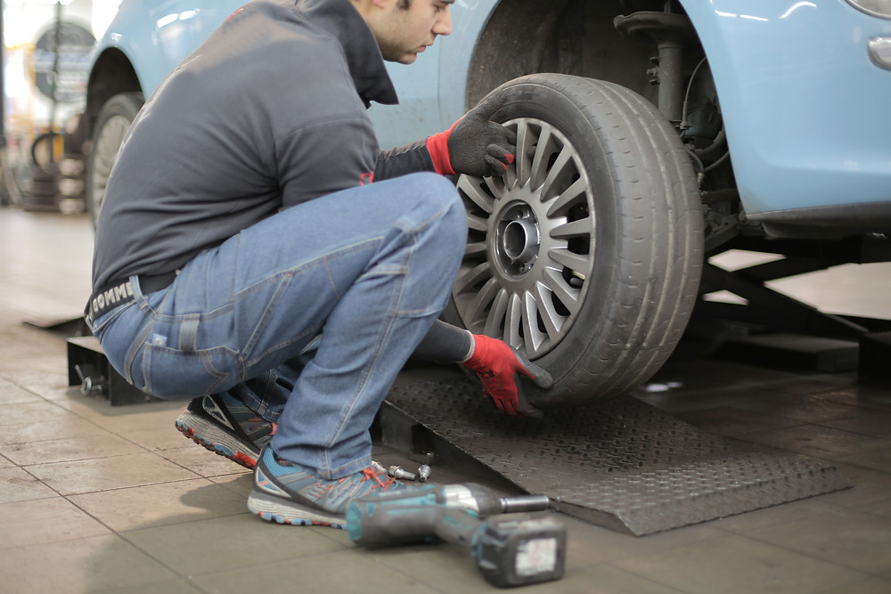 A mechanic changing a tyre