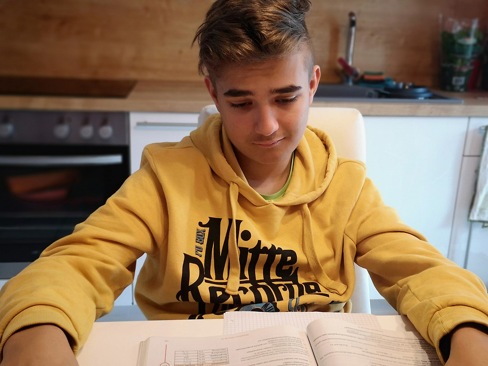 A sad student stares at a book