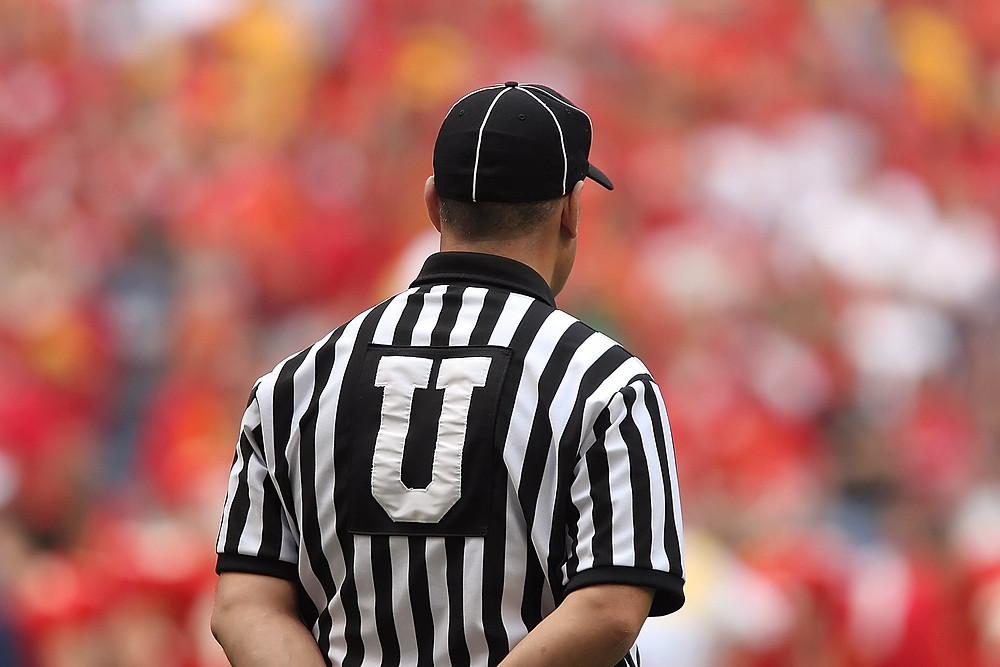 A referee watching an American Football game