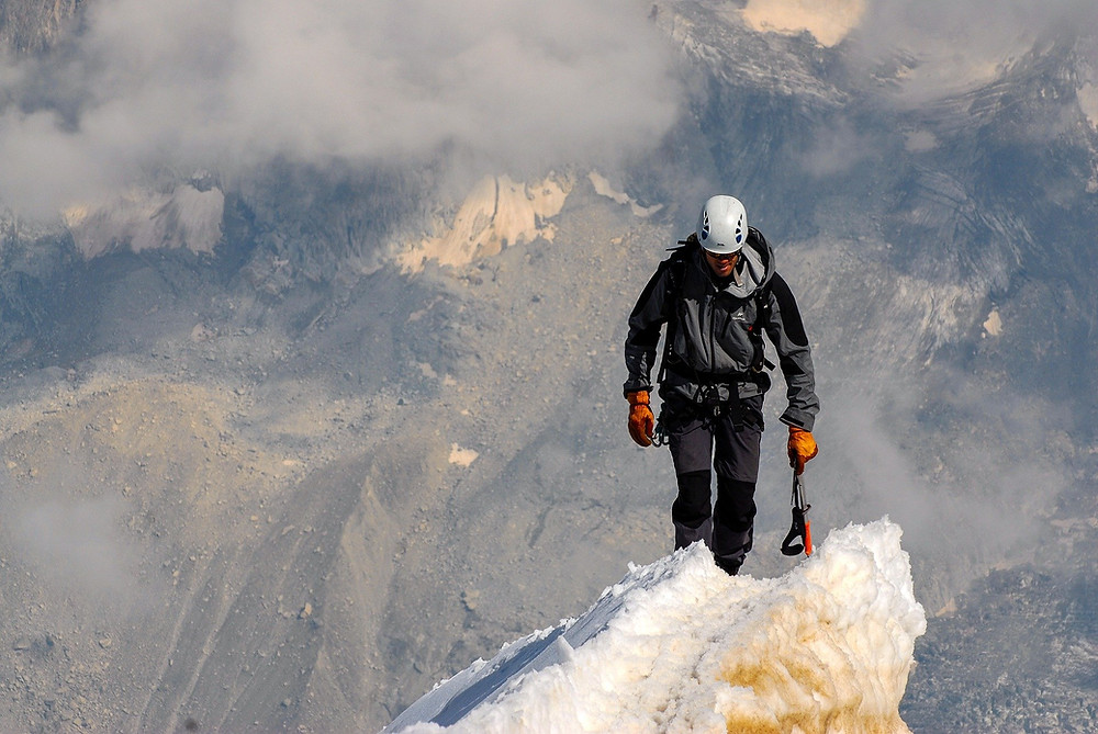 Man at the top of a summit