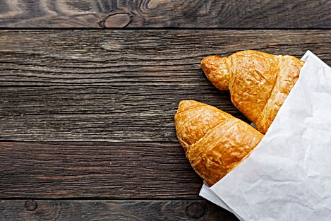 Canva - Tasty croissants in white paper
