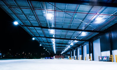 Canva - Industrial Warehouse at Night (1