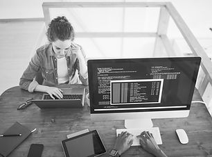 two-young-people-working-in-it-developme