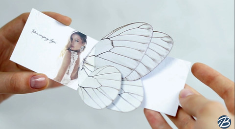 White butterfly business card