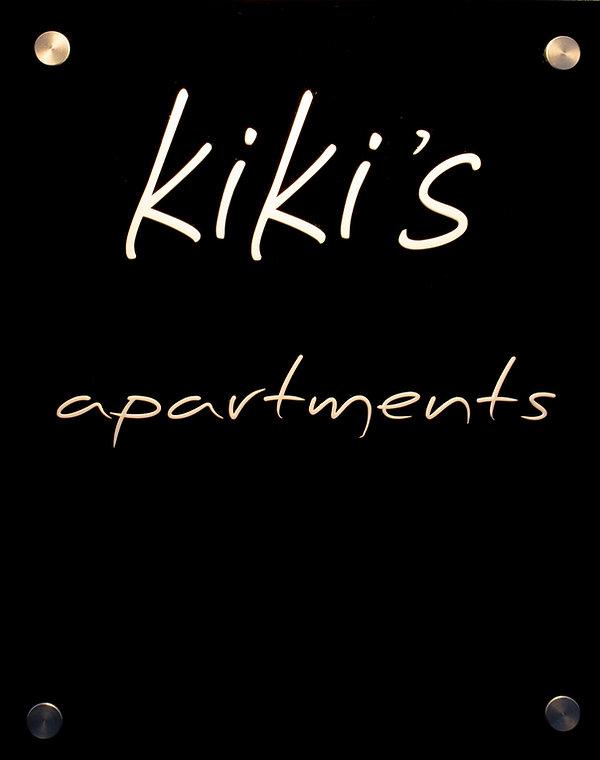 Kiki's Apartments sign