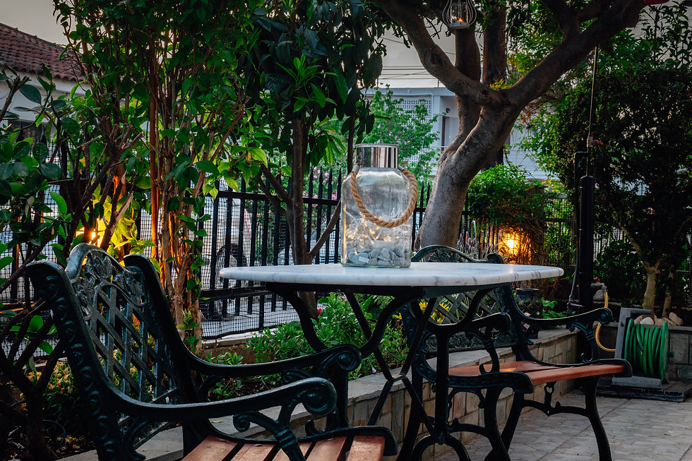 Kiki's Apartments garden table.jpg