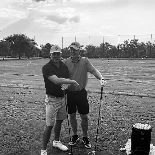 Founders father-Son pro golfing duo Hale Irwin and Steve Irwin posed on a gold course.