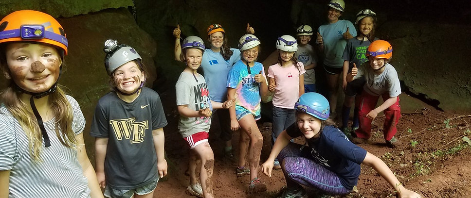 happy kids and counselors in the cave during ijams summer camp