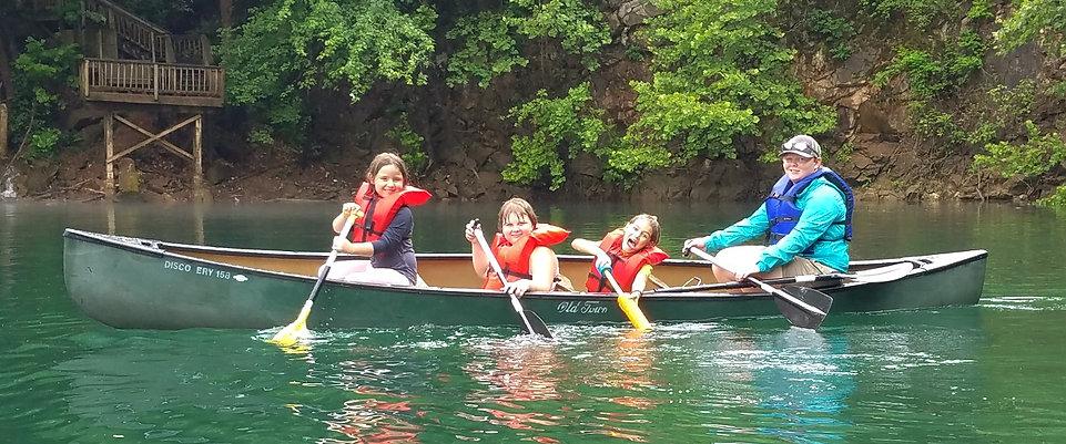 kids in canoe at ijams camp.jpg