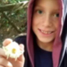 child holding animal skull in ijams homeshool class