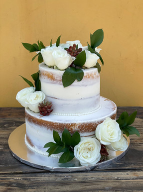 """6/10"""" Naked tiered cake with fresh floral"""