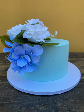 """8"""" round cake - buttercream with fake floral"""