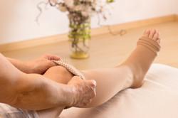 Female putting a compression stocking