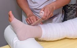 Bandaging and padding a leg