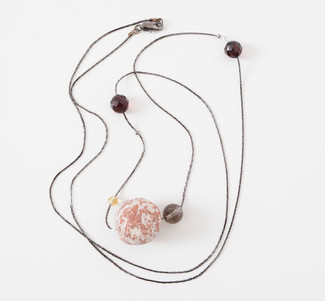 Shibumi necklace with ceramic bead and hand polished amber