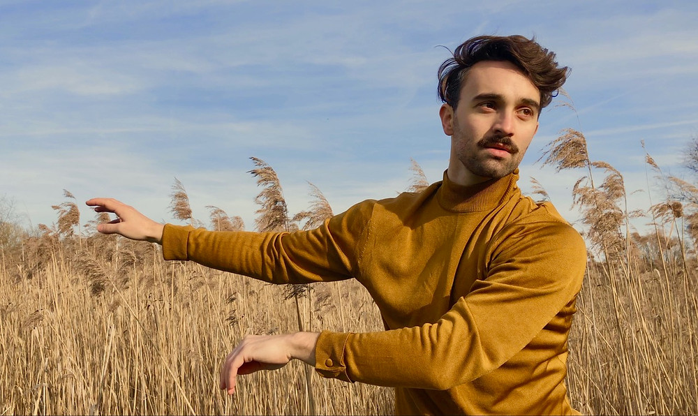 Georges Hann dancing in a field helping his mental health during the covid pandemic