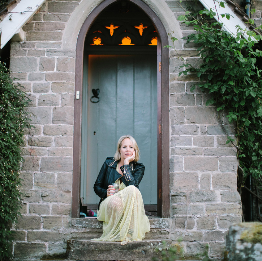 Jodie Cariss of The Self Space relaxing outside her home