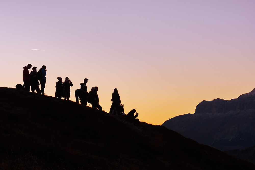 UK team Offsite hiking in the mountains at sunset