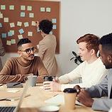group-of-men-sitting-indoors-3184288.jpg