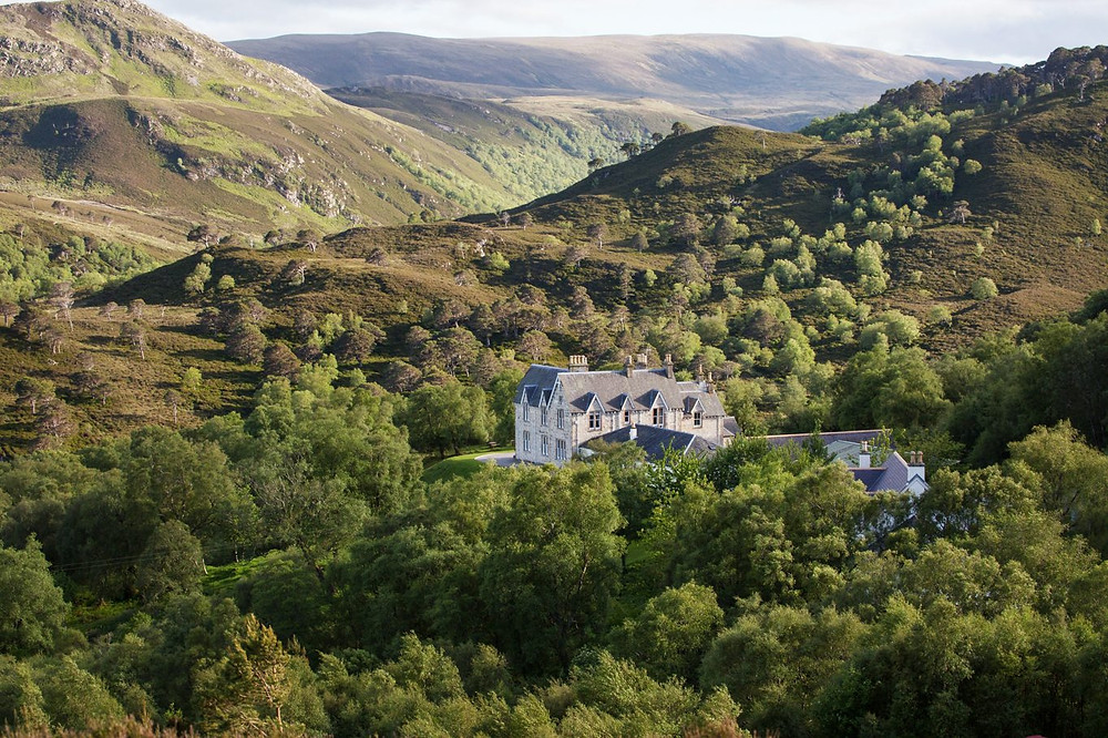 Alladale Wilderness Reserve in Sutherland, Scotland, surrounded by hills and woods