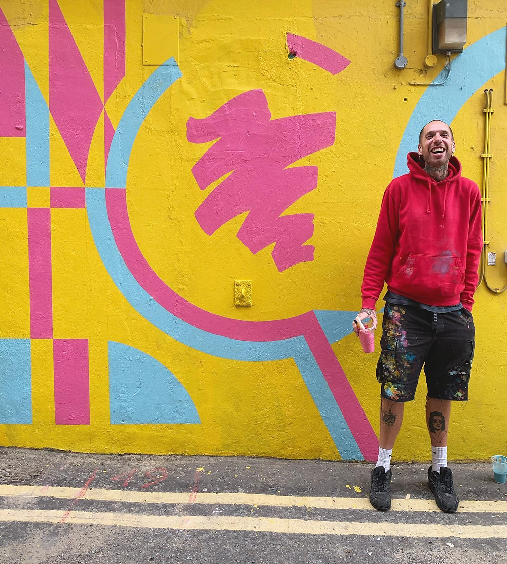 Creative Alex Noble in Margate next to his mural