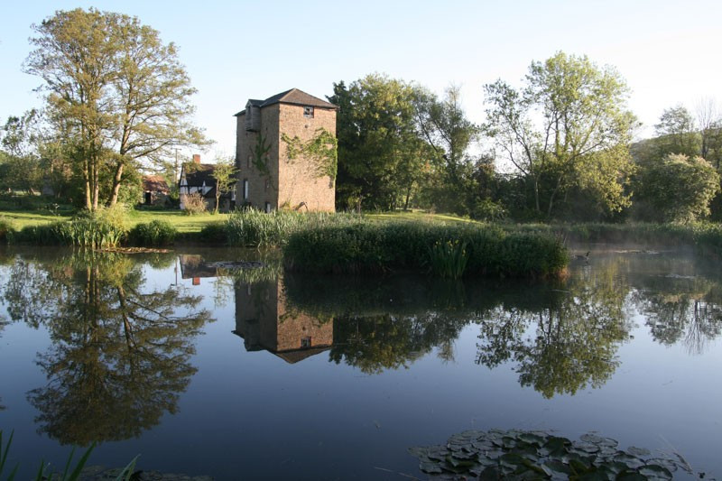 The Clover Mill, Worcestershire, on a lake with trees