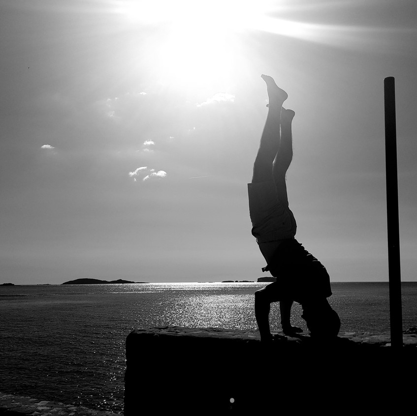 Daryl Woodhouse mental health specialist doing a headstand