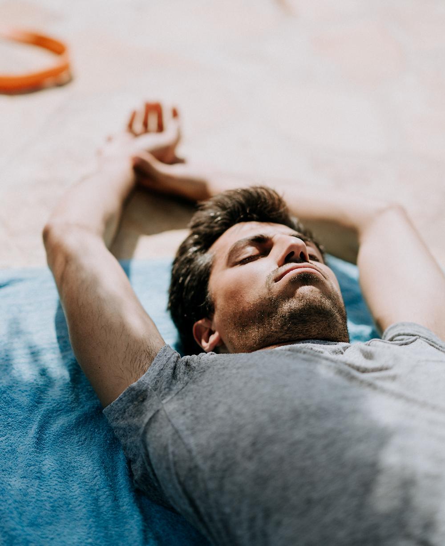 A man doing a breathwork session on a virtual retreat