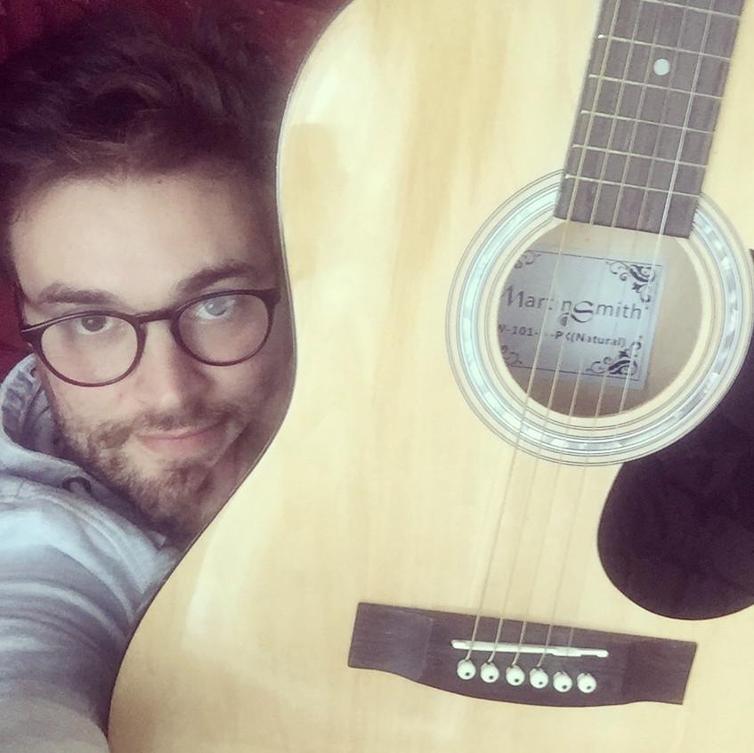 Jonny Benjamin mental health campaigner playing then guitar