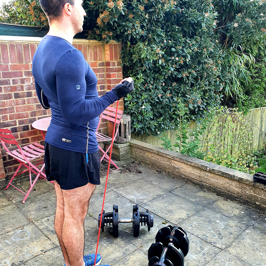 Daryl Woodhouse the speaker and trainer doing some exercise in his garden