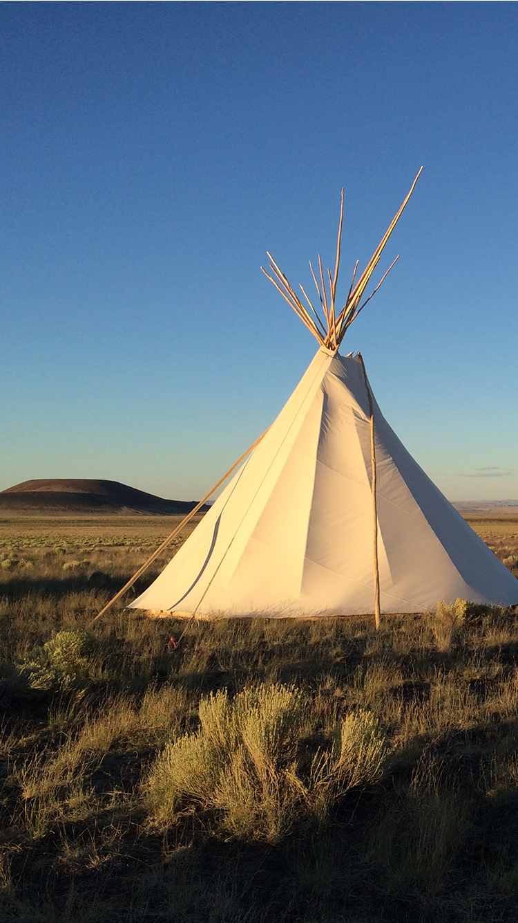 A meditation retreat in the desert with a teepee