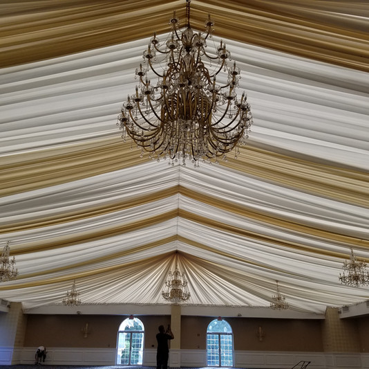White and gold celing liner and custom chandeliers
