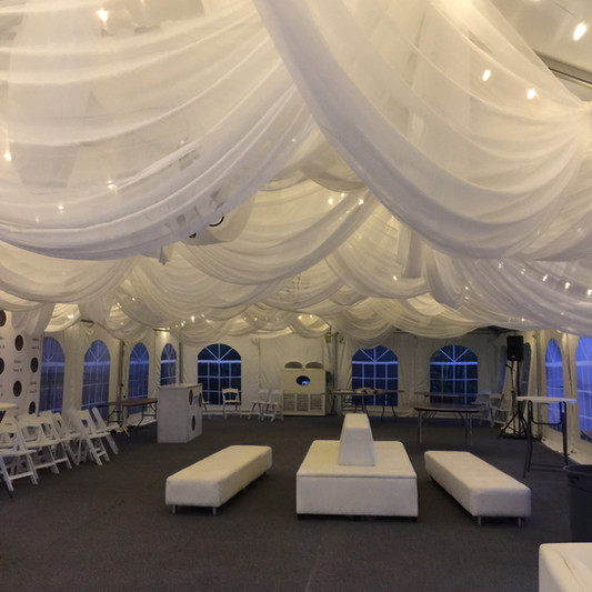 Ceiling swags with spontaneous hanging design embellished with market lighting (rental furniture was also added seen below)