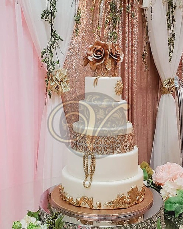 Beautiful White Wedding Cake with Gold Trim