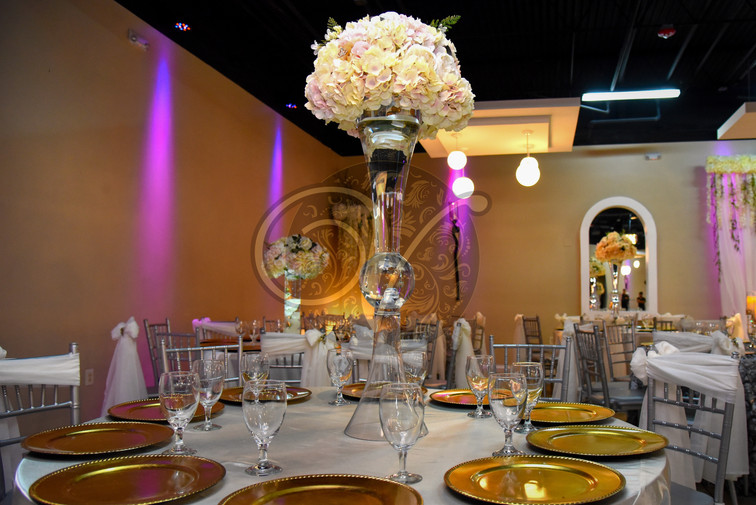 Gold dishes and floral centerpieces
