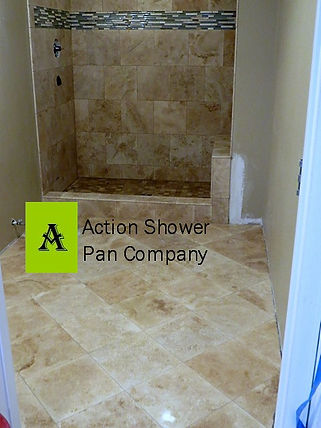 Castle Rock  travertine tile floor set in a diagonal pattern walls are set in a brick pattern with a glass tile liner