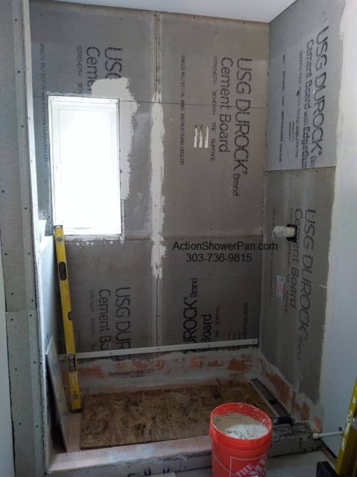 Tile ready shower installation. All of the seams are waterproofed with Schluter-Kerdi as the tile is being installed.