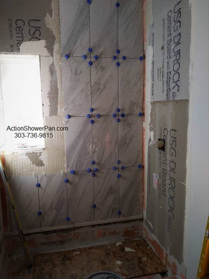 Tile is stacked in a vertical set pattern carefully matching the flow ot the tile patterns.