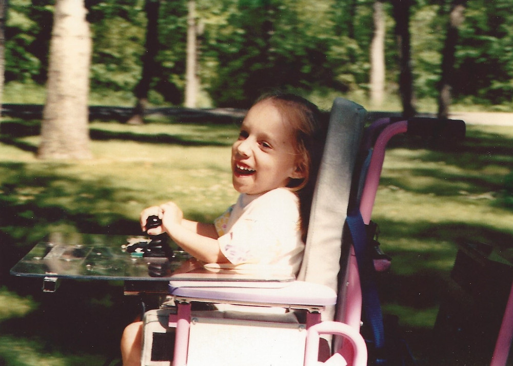 Riding my Barbie wheelchair in the park