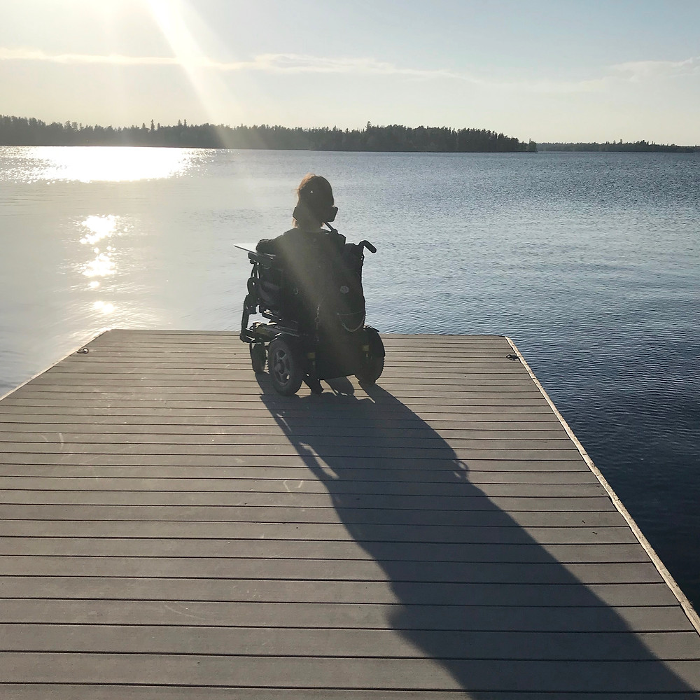 Me in my wheelchair looking out at the lake