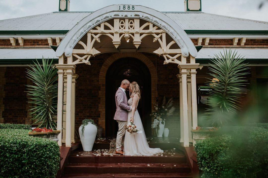 Bride and groom weetwood front steps.JPG