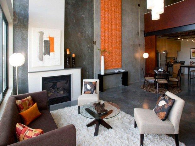 murs-salon-aspect-béton-gris-meubles-chaleureux