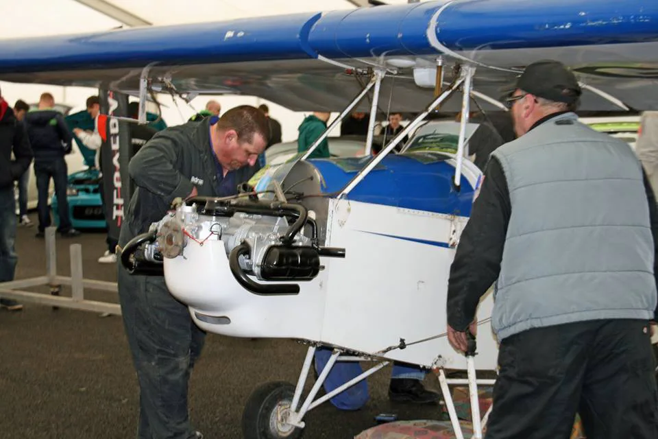 UAS Volunteers Adrian Evans and the late Harry Munn take an aircraft out to a local car show