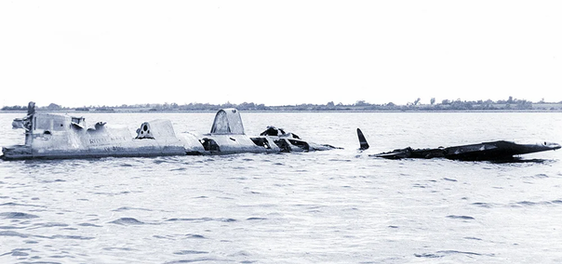Wreckage of Grumman Wildcat F4F JV482 lying in water and muddy depths of Portmore Lough, Northern Ireland